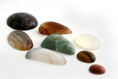 Polished Gemstones. A collection of polished gemstones / minerals, isolated on white royalty free stock photo
