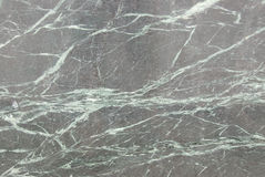 Polished granite. A polished slab of granite stock images