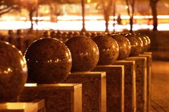 Polished granite balls at night. Abstract detail of urban realm.  royalty free stock photo