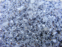 Polished granite grey texture. Corian Stock Image