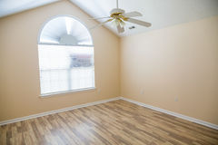 Polished Hardwood Floor in New Home with ceiling Fan Stock Photography