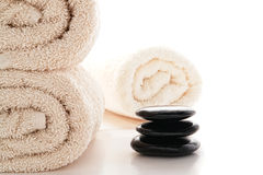 Polished Hot Massage Stones Cairn and Bath Towels Stock Image
