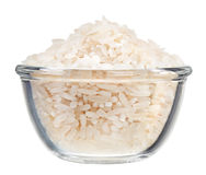 Polished long rice heap in small glass bowl Royalty Free Stock Image