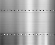 Polished metal background with rivets. Polished brushed metal background with rivets stock photo