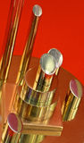 Polished metal rods on a red background Royalty Free Stock Image