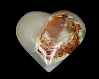 Polished multicolor carved onyx heart Stock Photo