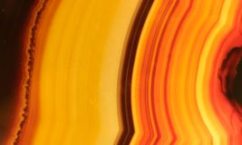 Polished onyx mineral stone with orange, yellow, brown and red stripes stock photos