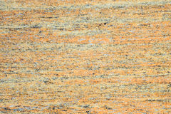 Polished orange grain granite Royalty Free Stock Image