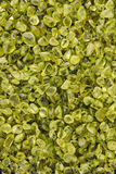 Polished Peridot Background Stock Photo