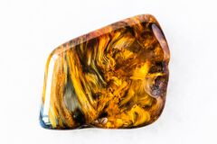 Free Polished Pietersite Rock On White Marble Stock Image - 196522651