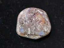 Polished porphyry gemstone on dark background Stock Images
