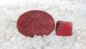 Polished rhodonite cabochons Royalty Free Stock Photography