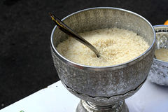 Polished rice in thai metal bowl Stock Photography
