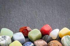 Colorful gemstones on slate stone Stock Photo