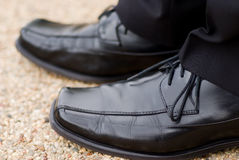 Polished Shoes. Dressy Black Shoes, worn by a trendy business man or by a groom on his wedding day Royalty Free Stock Photography