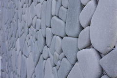 Polished Stone. Wall made with Polished Stone show Pattern that Arrange High and Wide Royalty Free Stock Photography