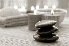 Polished Stone Cairn and Candles Burning in a Spa Stock Images