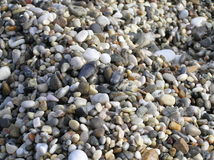 Polished stones. Sea polished stones on the cost of Mediterranean sea stock photos