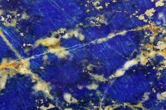 Polished surface of Lapislazuli. Polished surface of a Lapislazuli rock Royalty Free Stock Images