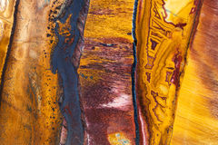Polished surface of Tiger's eye mineral gem stone Royalty Free Stock Image