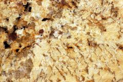 The polished surface of the yellow granite, called Giallo Veneziano Royalty Free Stock Photos