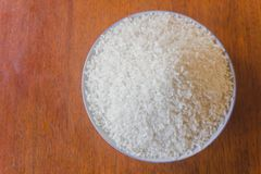 Polished white rice in plate on top view close up stock images