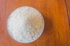Polished white rice in plate on top view close up stock photography