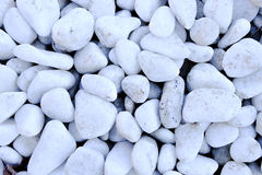 Polished white rock. Small naturally polished white rock, decorative white rock Royalty Free Stock Image