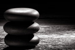 Polished Zen Massage Stones Cairn on Vintage Wood Royalty Free Stock Photos