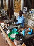 Polisher jeweler is making raw processing of gems (precious stones). Stock Photography