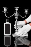 Polishing a beautiful candelabra. By a servant Stock Images