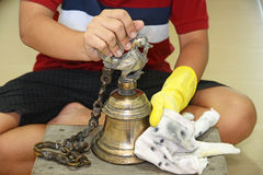 Polishing A Brass Bell Stock Images