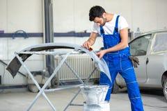 Polishing bumper for paint job Stock Image