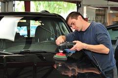 Polishing a car. Man polishing a car bonnet Stock Images
