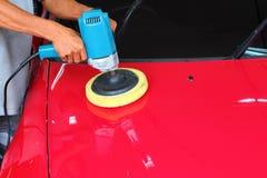 Polishing the car. Polishing automobile the carwash service Royalty Free Stock Photos