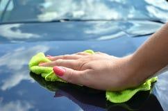 Polishing a car. Hand with cloth polishing a car Stock Photos