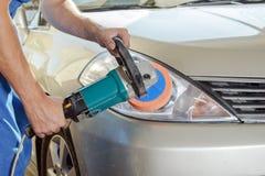 Polishing car headlight Royalty Free Stock Photos
