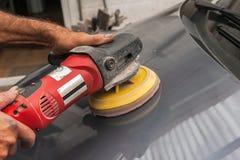 Polishing a car Royalty Free Stock Images