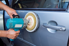 Polishing the car with power buffer machine Royalty Free Stock Photo