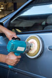Polishing the car with power buffer machine Royalty Free Stock Photos