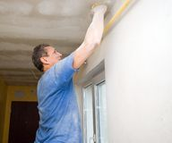 Polishing ceiling Royalty Free Stock Photo