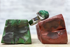 Polishing Compounds. Red and Green Polishing Coumpounds and a Polished Silver Ring Stock Photo