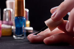 Polishing fingernails Stock Photography