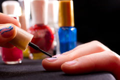 Polishing fingernails Stock Images