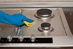 Polishing a gas stove Royalty Free Stock Image