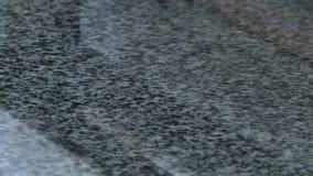 Polishing granite slabs on production. Granite processing in manufacturing. Polishing granite plate on the machine stock footage
