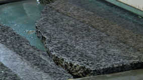 Polishing granite slabs on production. Granite processing in manufacturing. Polishing granite plate on the machine stock video footage