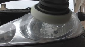 Polishing the headlights of cars. stock video footage