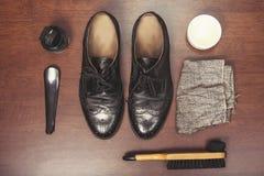 Polishing leather shoes Stock Photos