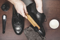 Polishing leather shoes Stock Image